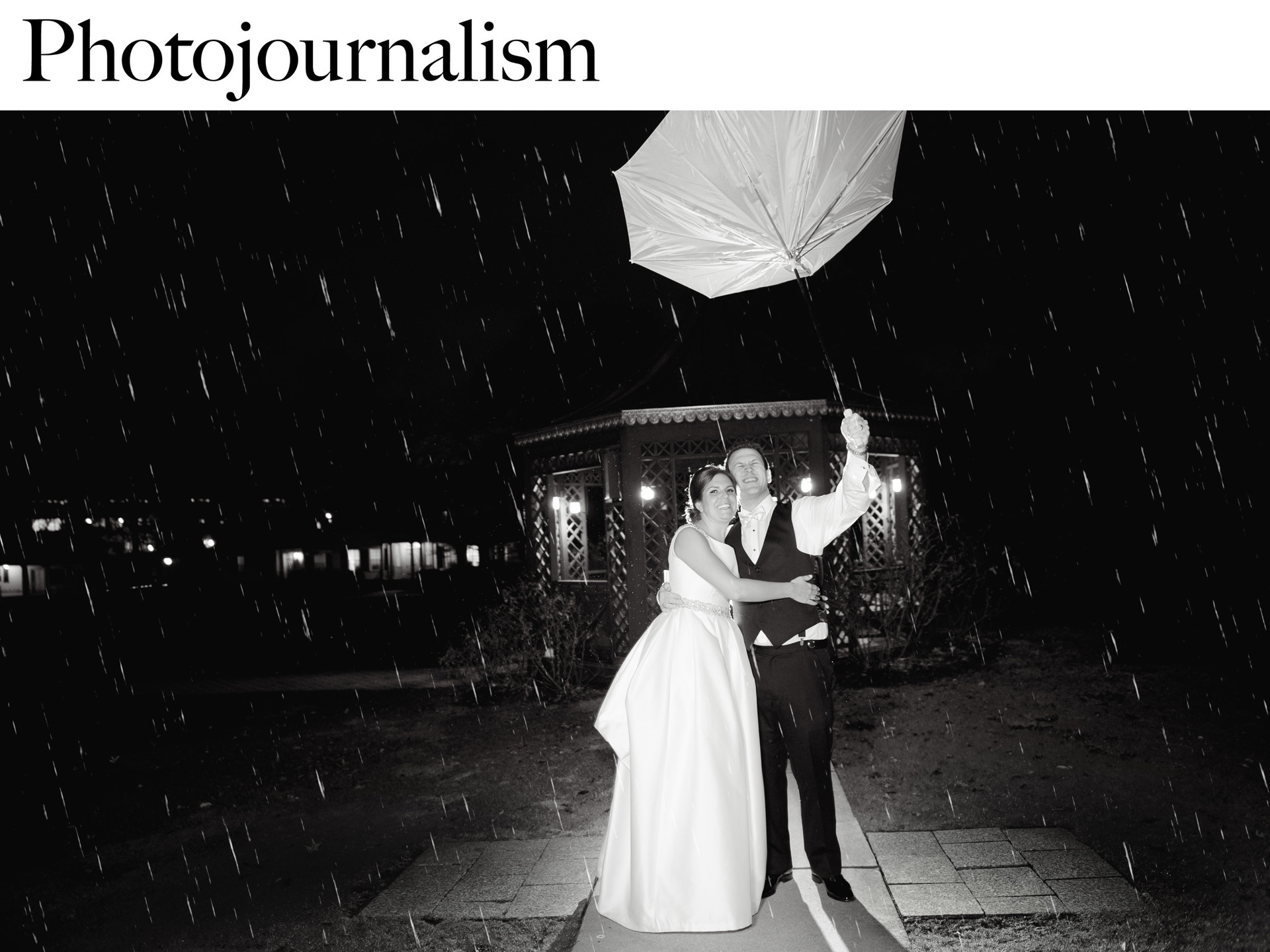 The bride and groom struggle during the rain after their Dearborn Inn wedding in Dearborn, Michigan.