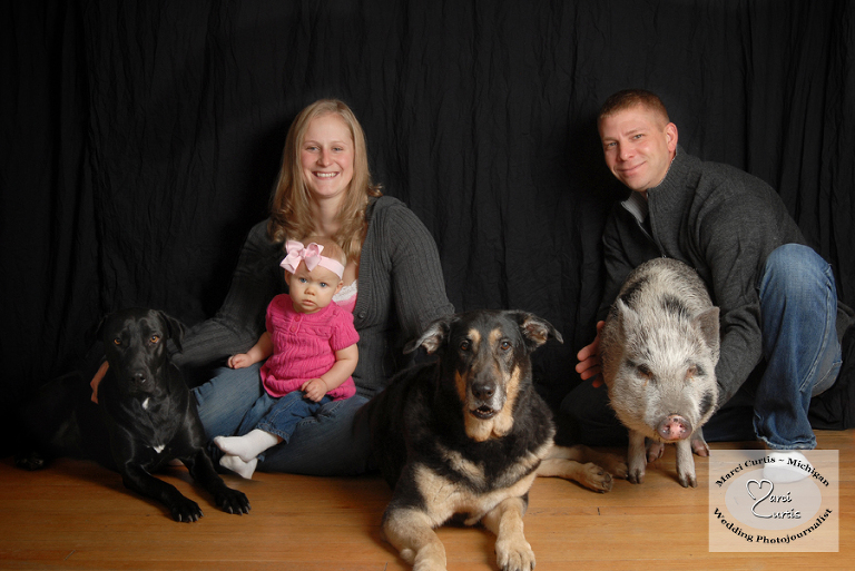 detroit michigan family photo including dogs and pigs