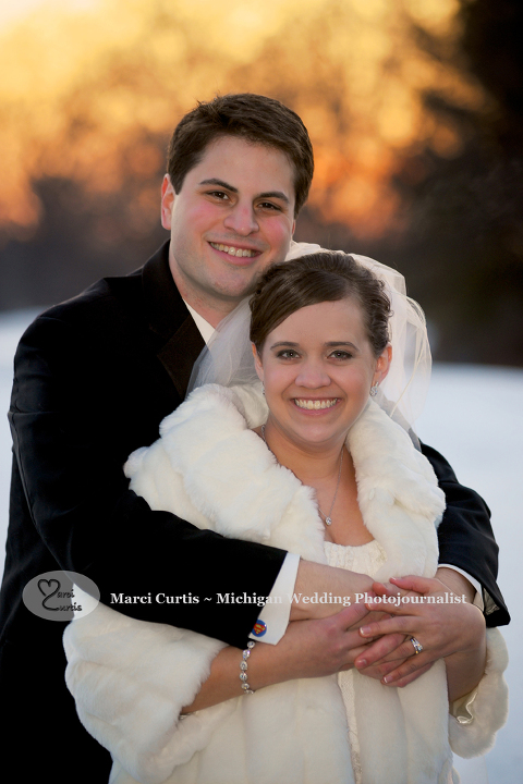 Couple from Ann Arbor wedding at Travis Pointe Country Club in Michigan.