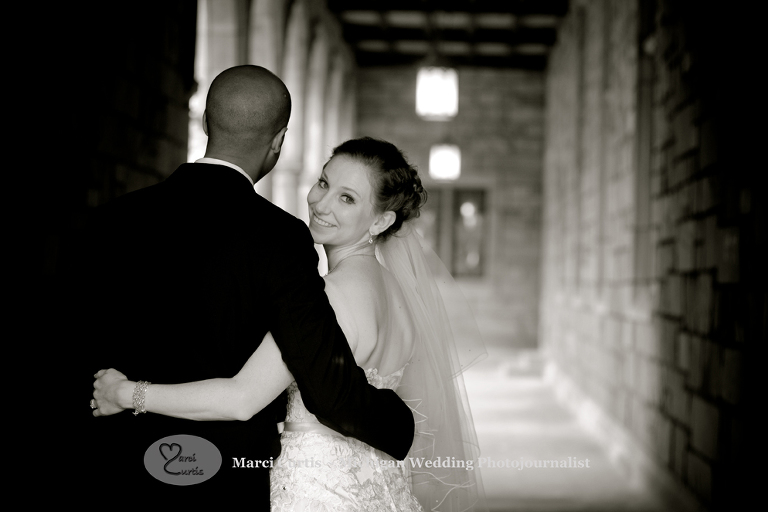 University of Michigan bride looks back over her shoulder during wedding photo shoot.