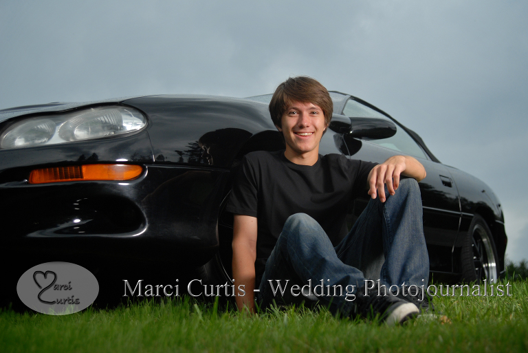 Senior poses with his car in Bloomfield, Michigan during a rain storm.