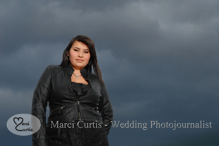 Senior posed in front of a major thundercloud.