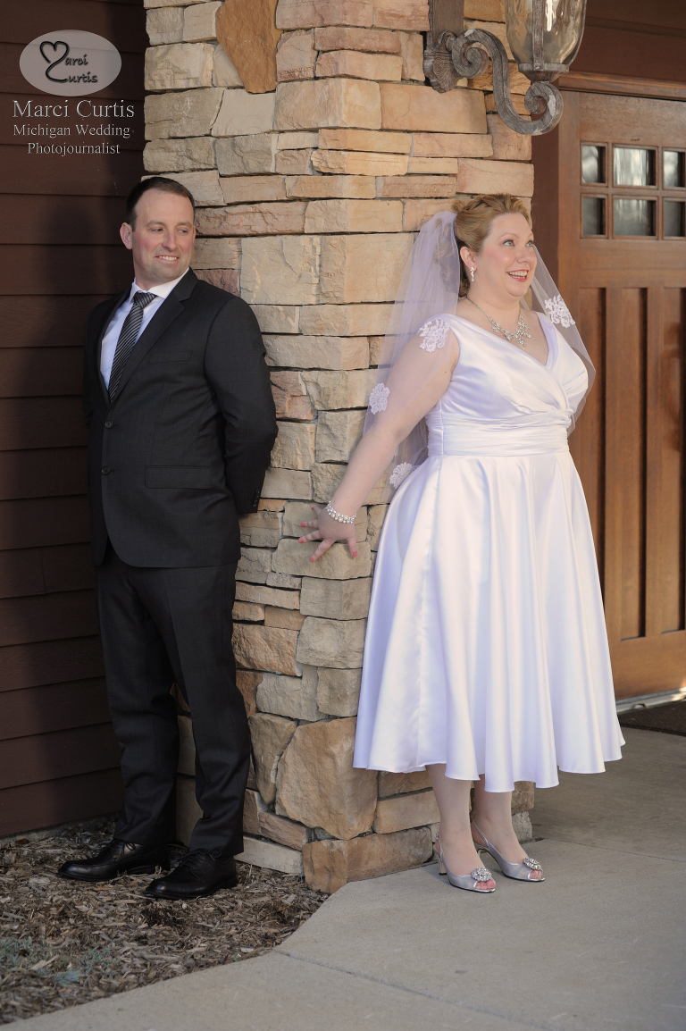 Bride and groom at their first look outside the Iroquois Club in Bloomfield Michigan.
