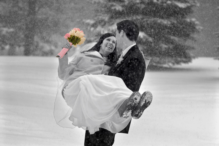 Michigan snow wedding photos featuring a couple out in the snow in Troy.
