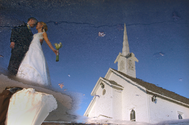 Detroit Winter Wedding Photography featuring a couple reflected in ice outside their church.