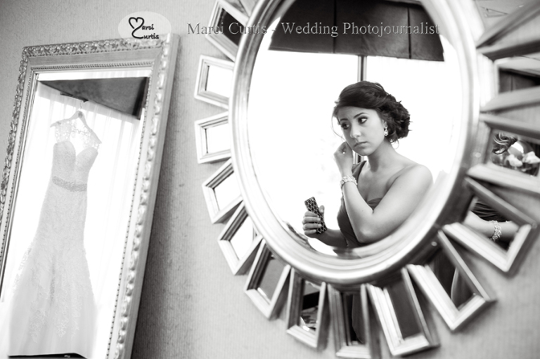 One of Gina's bridesmaids gets ready at the Crowne Plaza hotel in Auburn HIlls in Michigan.