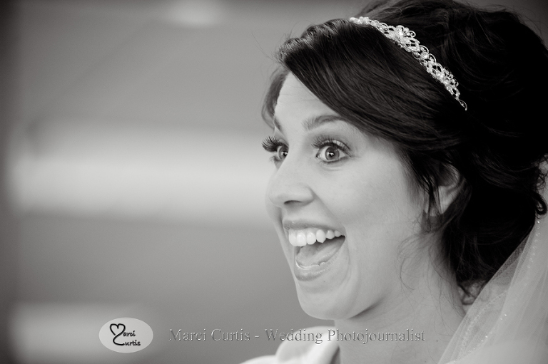 Bride, Gina, reacts to something funny someone said just prior to her wedding in Rochester, Michigan.