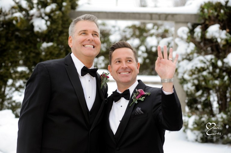 Same sex couple in Rochester, Michigan wave up to one other their family members during our shoot at the Royal Park Hotel in Rochester, Michigan.
