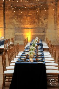 Jam Handy wedding location set for farm table style seating for wedding.