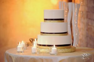 Wedding cake with yellow uplighting at the Jam Handy in Detroit, Michigan.