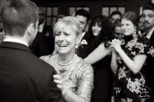 Mother of the groom cries during her dance with her son at Jam Handy.