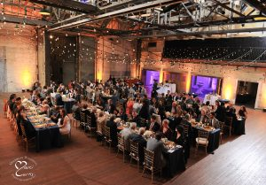 Overall view of dinner being served at the Jam Handy in Detroit during an event.