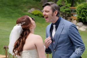 The groom checks his teeth in his mirrored sunglasses at this comedy duo's Detroit wedding.
