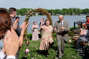The groom's grandmother dances down the aisle after her comedian grandson's lakeside Michigan wedding.