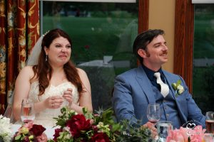 The bride and groom react very differently to the toasts at the White Oaks Golf Course wedding in White Lake, Michigan.