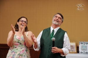 The groom's parents react to the toasts at the White Oaks Golf Course wedding in White Lake, Michigan.