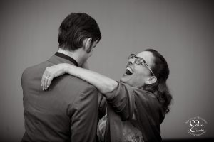 The groom and his mother enjoy their first dance together at the White Oaks Golf Course wedding in White Lake, Michigan.