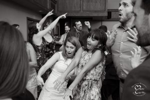 Guests enjoy dancing on the dance floor of the White Oaks Golf Course wedding in White Lake, Michigan.
