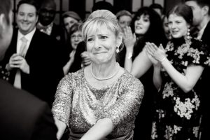 Pick a photographer who can capture emotions like this mother of the groom during the mother / son dance.