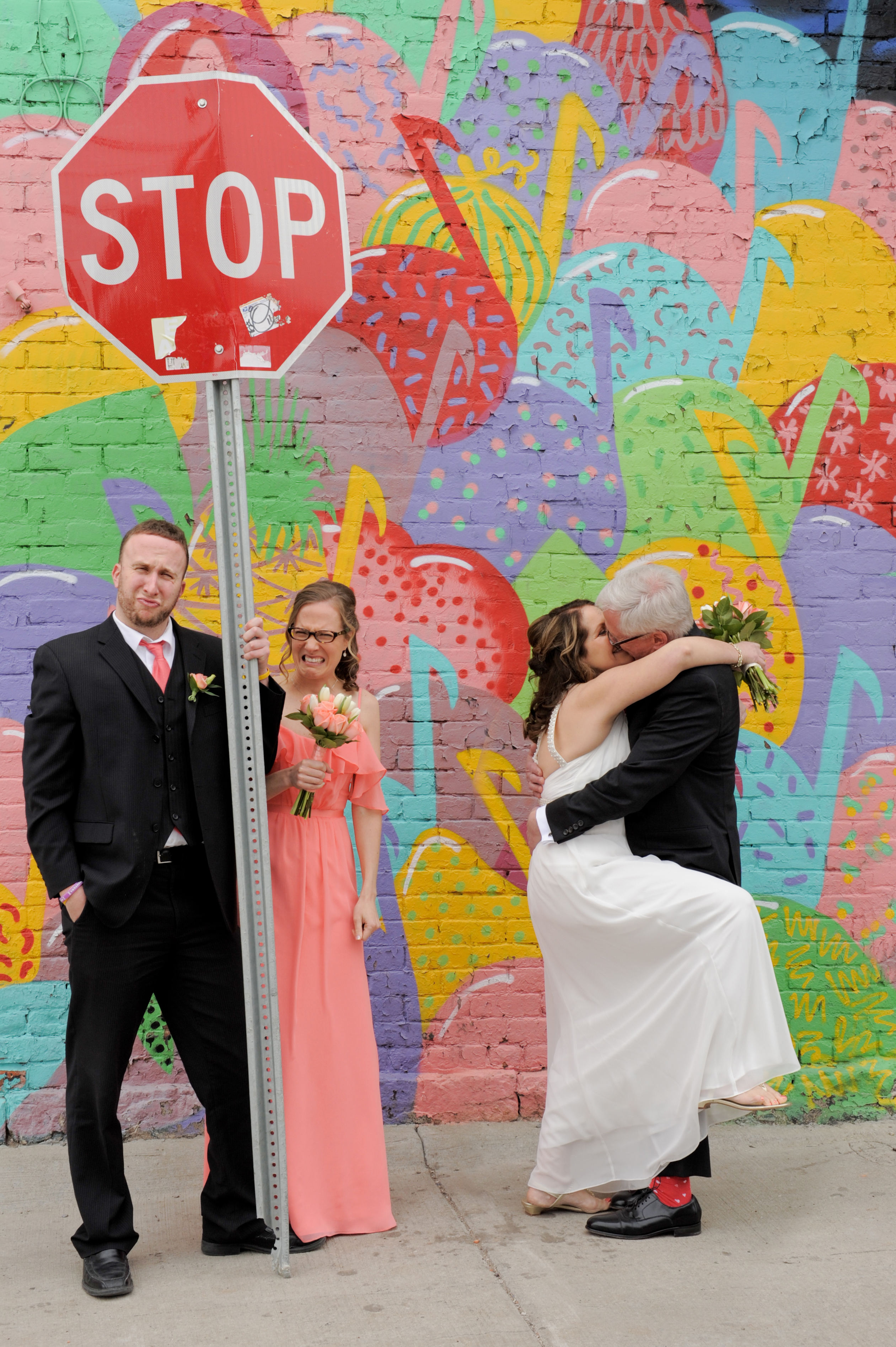 Eastern Market blended family wedding. Yes, THEY wanted to pose with this sign! Photos by Marci Curtis