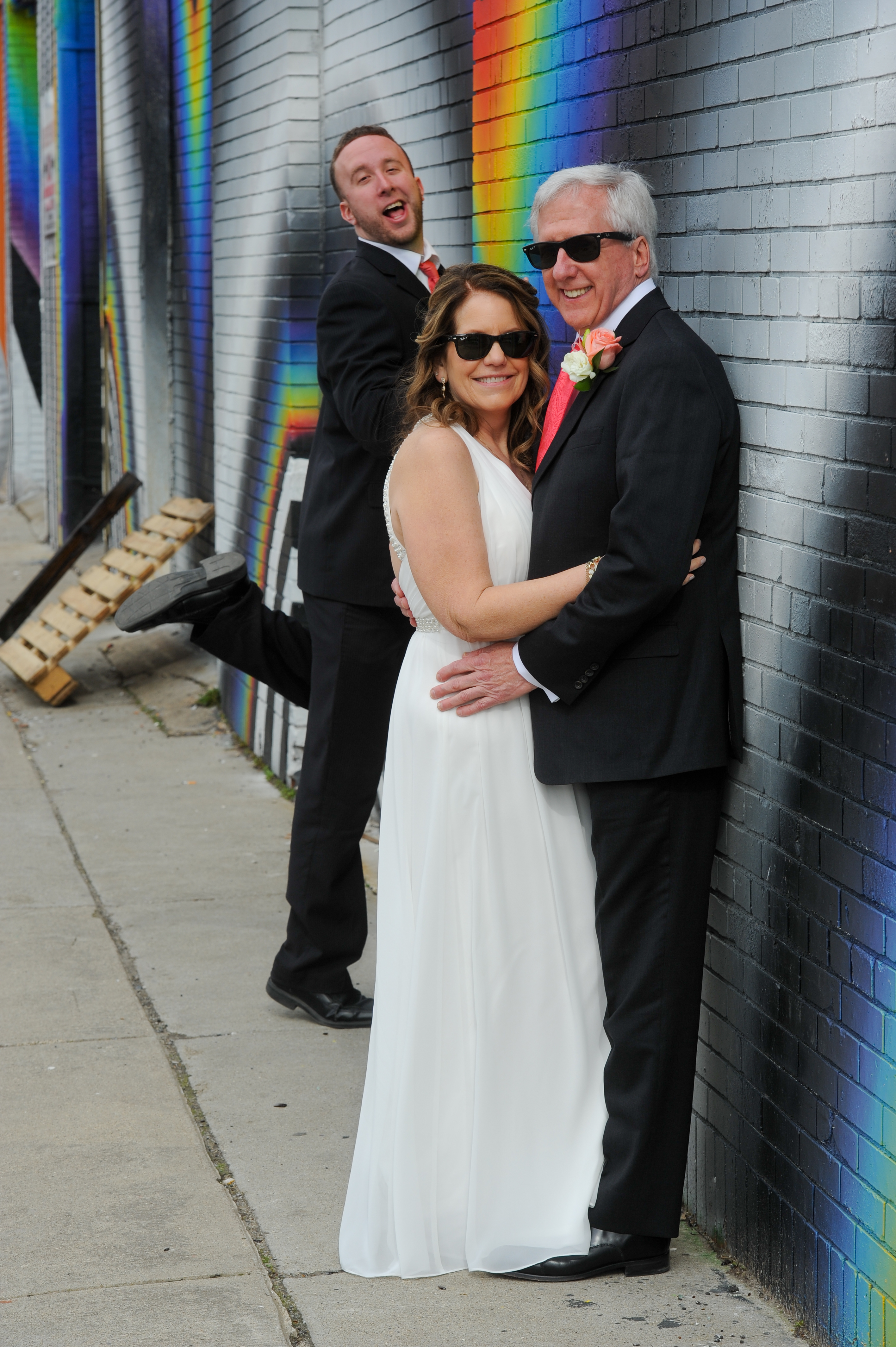 Michigan couple celebrate their second wedding while his son makes fun of them. Photos in Detroit's Eastern Market. Photos by Marci Curtis