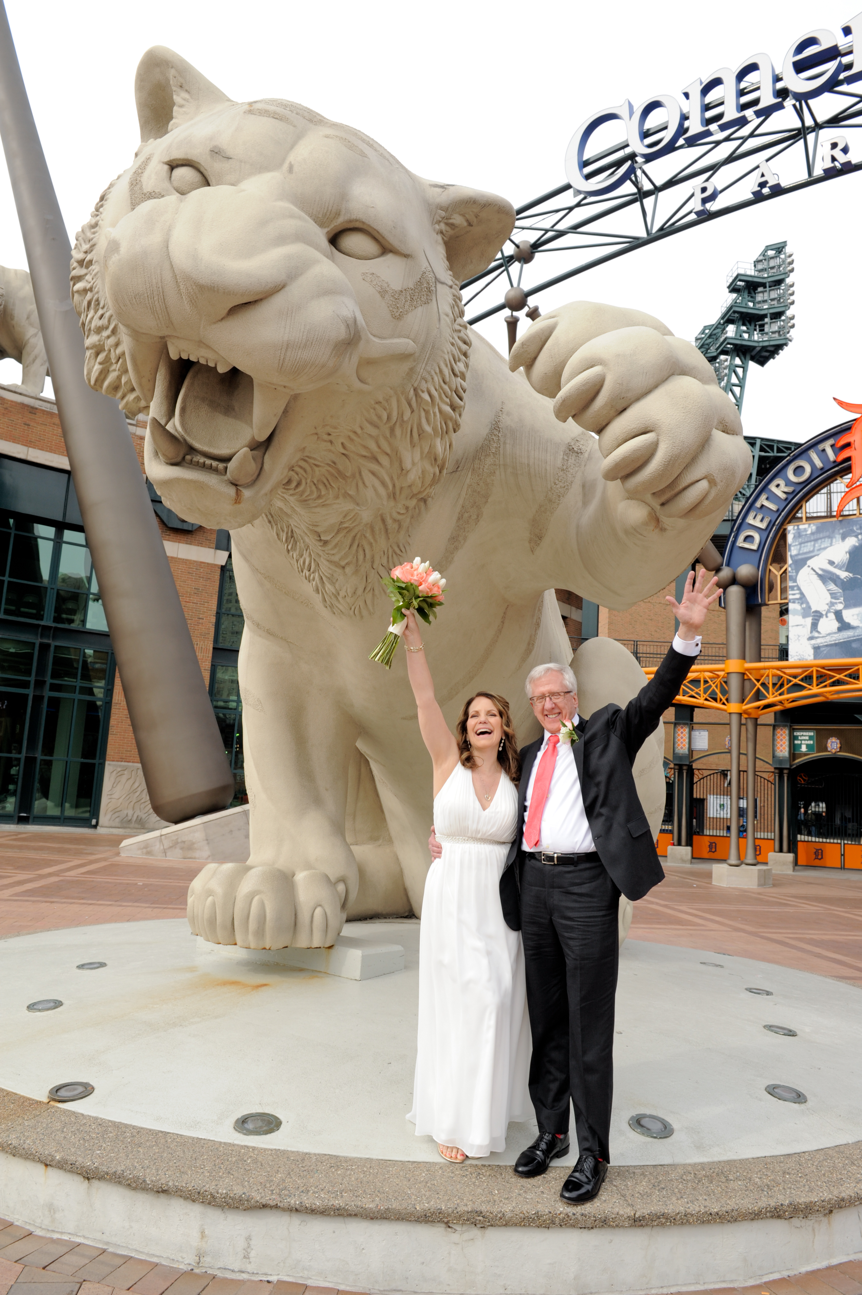 Michigan couple celebrate their second wedding with a few quick photos at Comerica Park. Photos by Marci Curtis