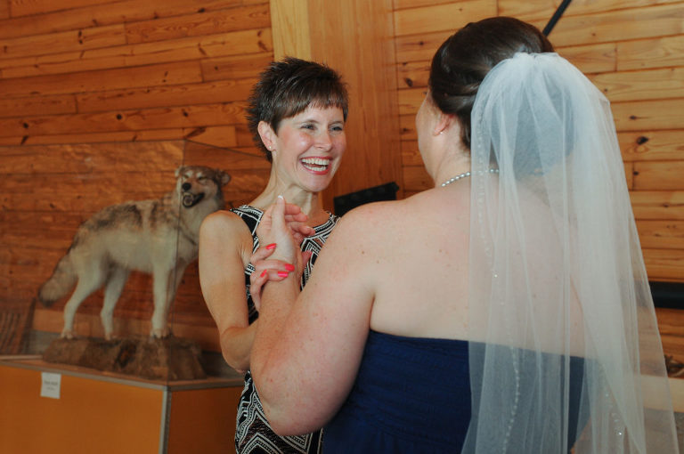 The bride greets her sister in law before her wedding at Indian Springs Metropark in White Lake, Michigan.