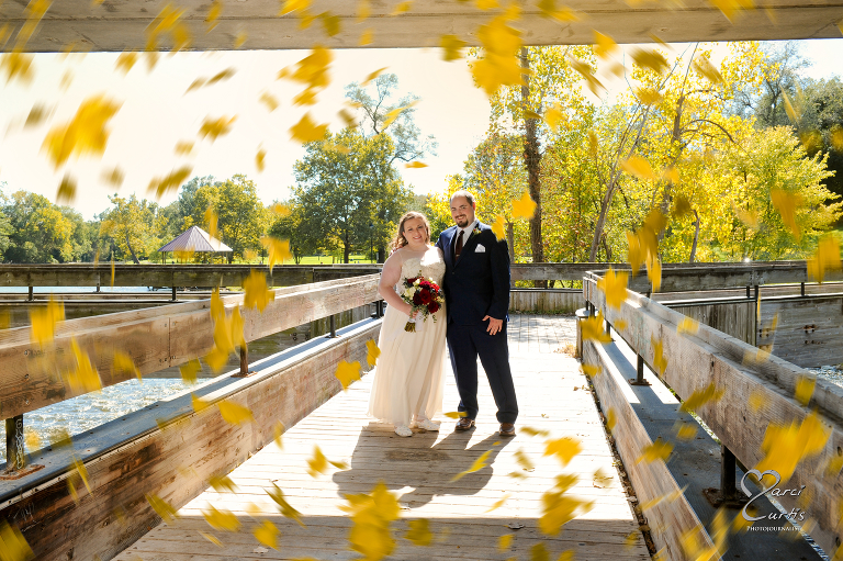 The bride and groom in the fall. Ypsilanti Freighthouse wedding photography of the newly renovated historic building in Depot Town, Ypsilanti, Michigan.