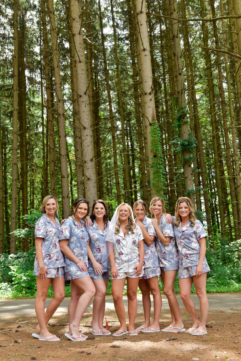 The bride and bridesmaids wore matching wedding PJs just outside the bridal suite for a quick photo before getting ready at Shepherd's Hollow Golf Club.