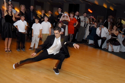 A Ferndale, Michigan wedding couple break dance at their wedding reception.