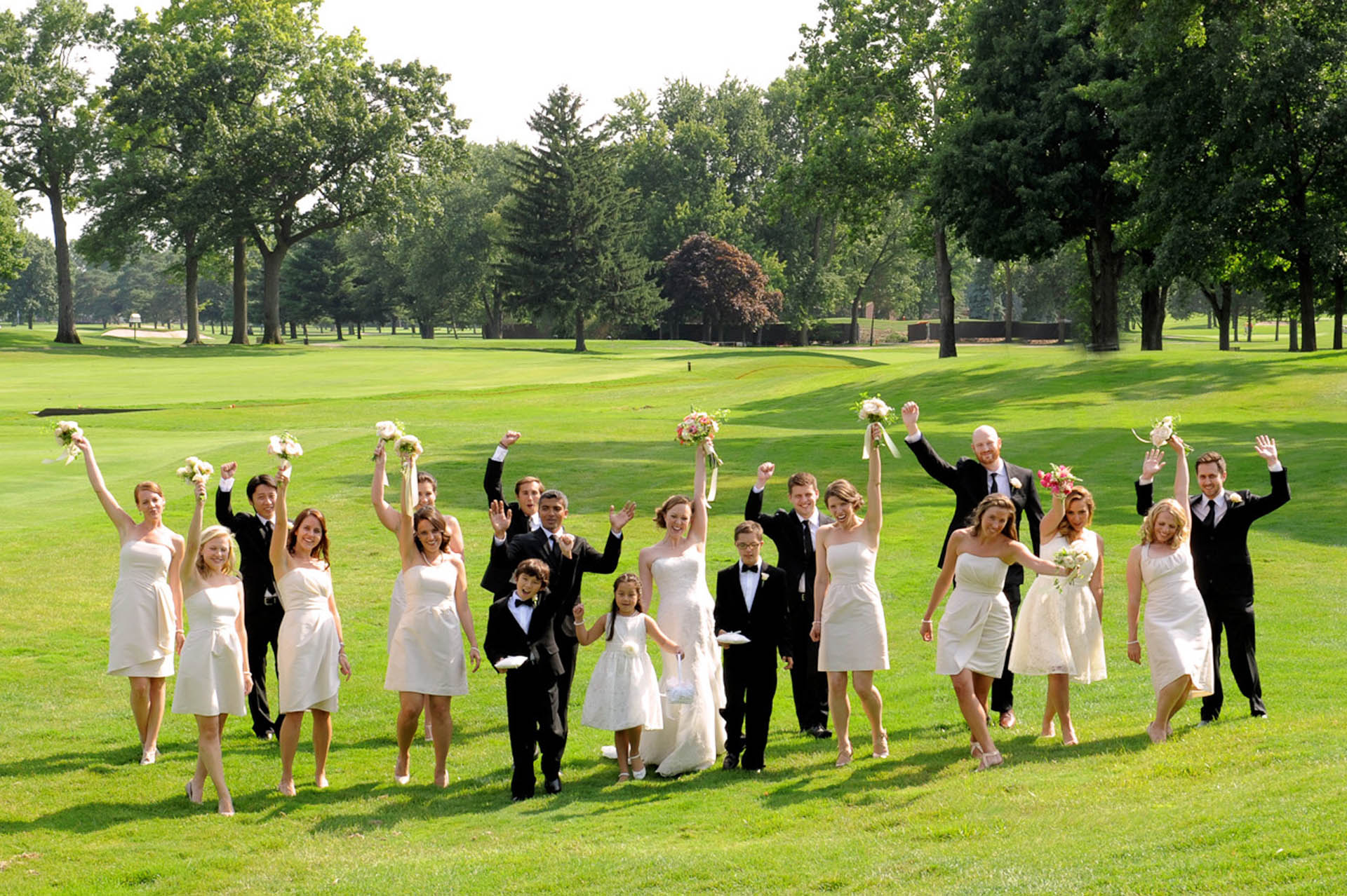 Detroit Golf Club wedding photographer's photo of the bridal party goofing around at the Detroit Golf Club.