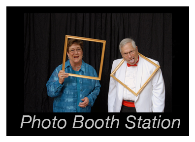 A huge backdrop offers a lot of fun at this Michigan wedding photo booth station.