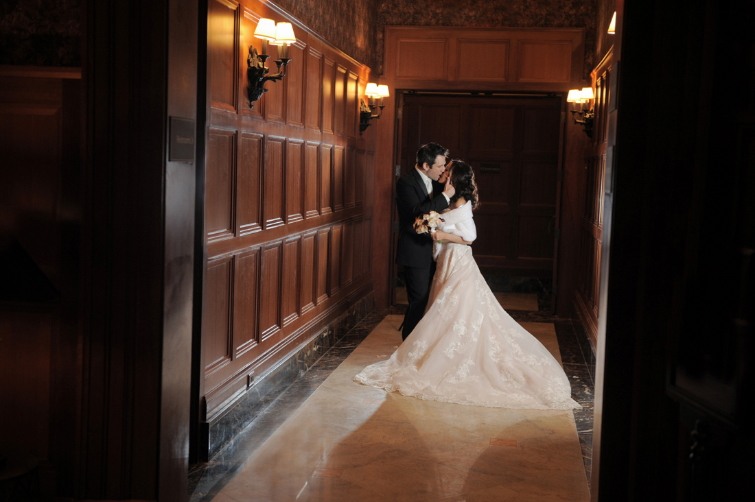 An artistic couple at the Royal Park Hotel in Rochester share a spectacularly hollywood style kiss after their intimate ceremony in Rochester, Michigan.