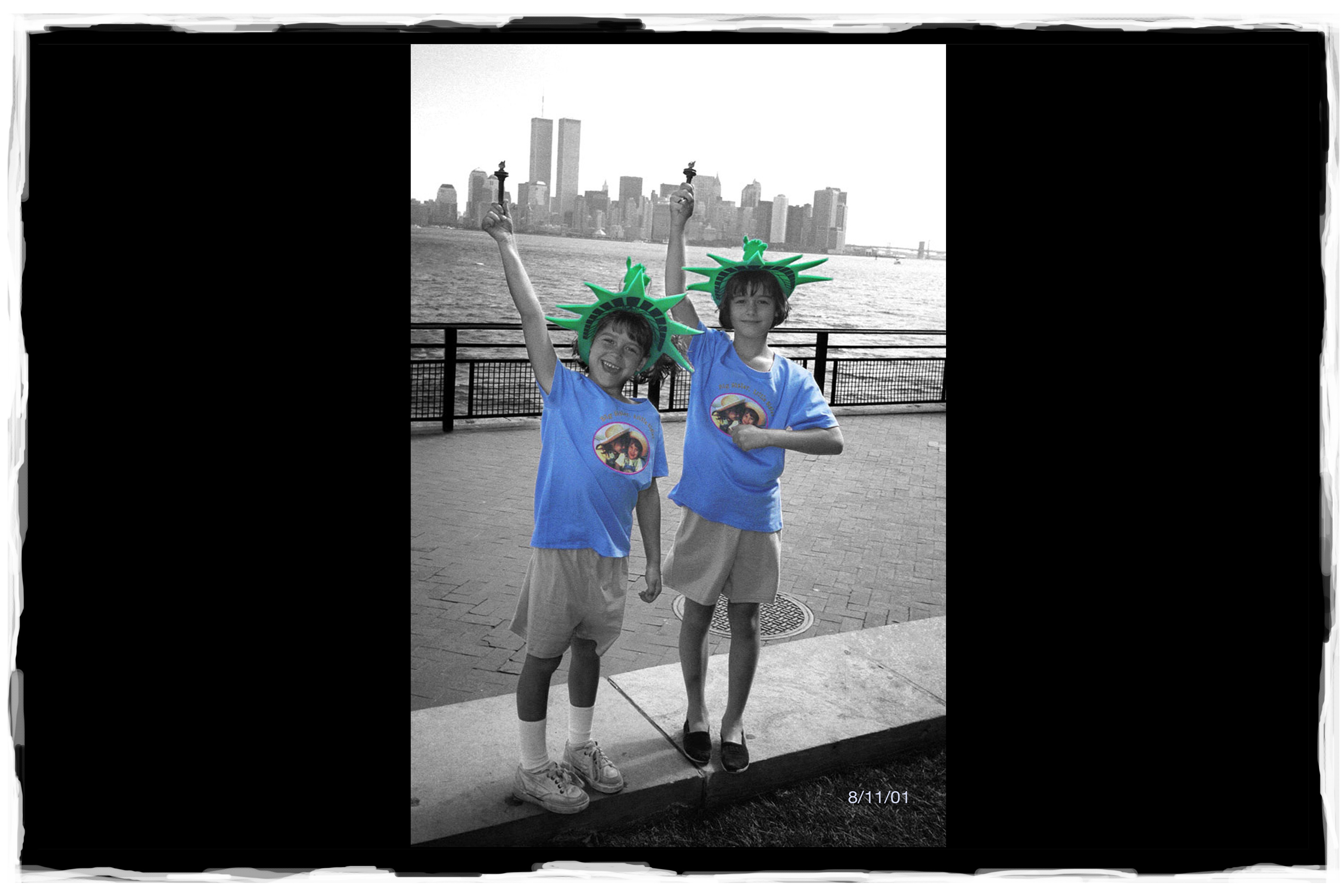 A photo taken of my two girls in front of the Twin Towers on August 11th, 2001.