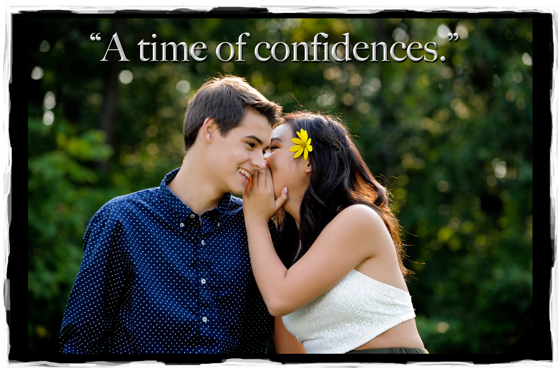 A Detroit area high school couple whisper during their senior romeo and juliet photo in Rochester, Michigan.