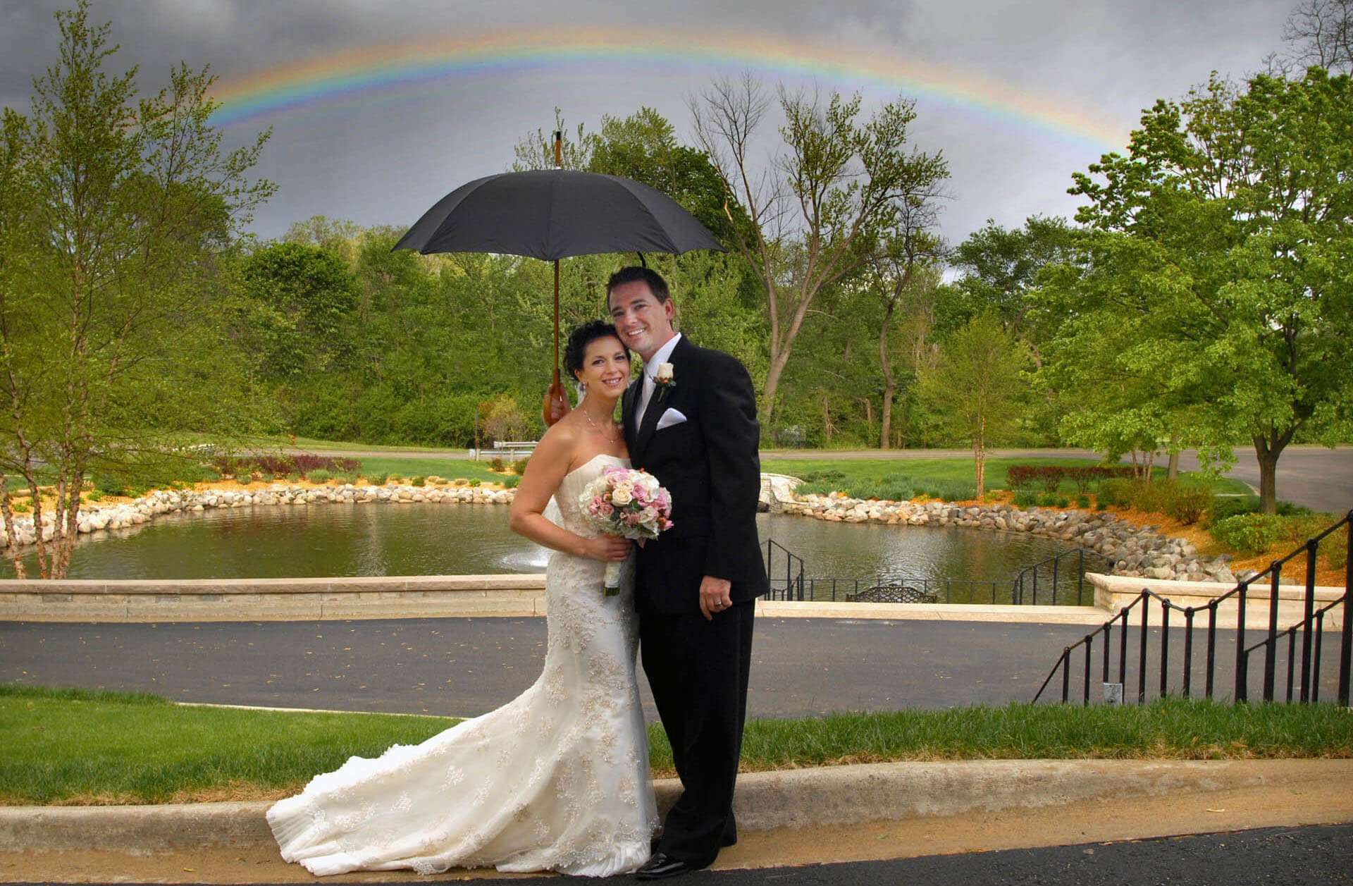 The bride and groom certainly started off their wedding with a lucky rainbow appearing just after their St. Hugo of the Hills wedding in Bloomfield, Michigan.