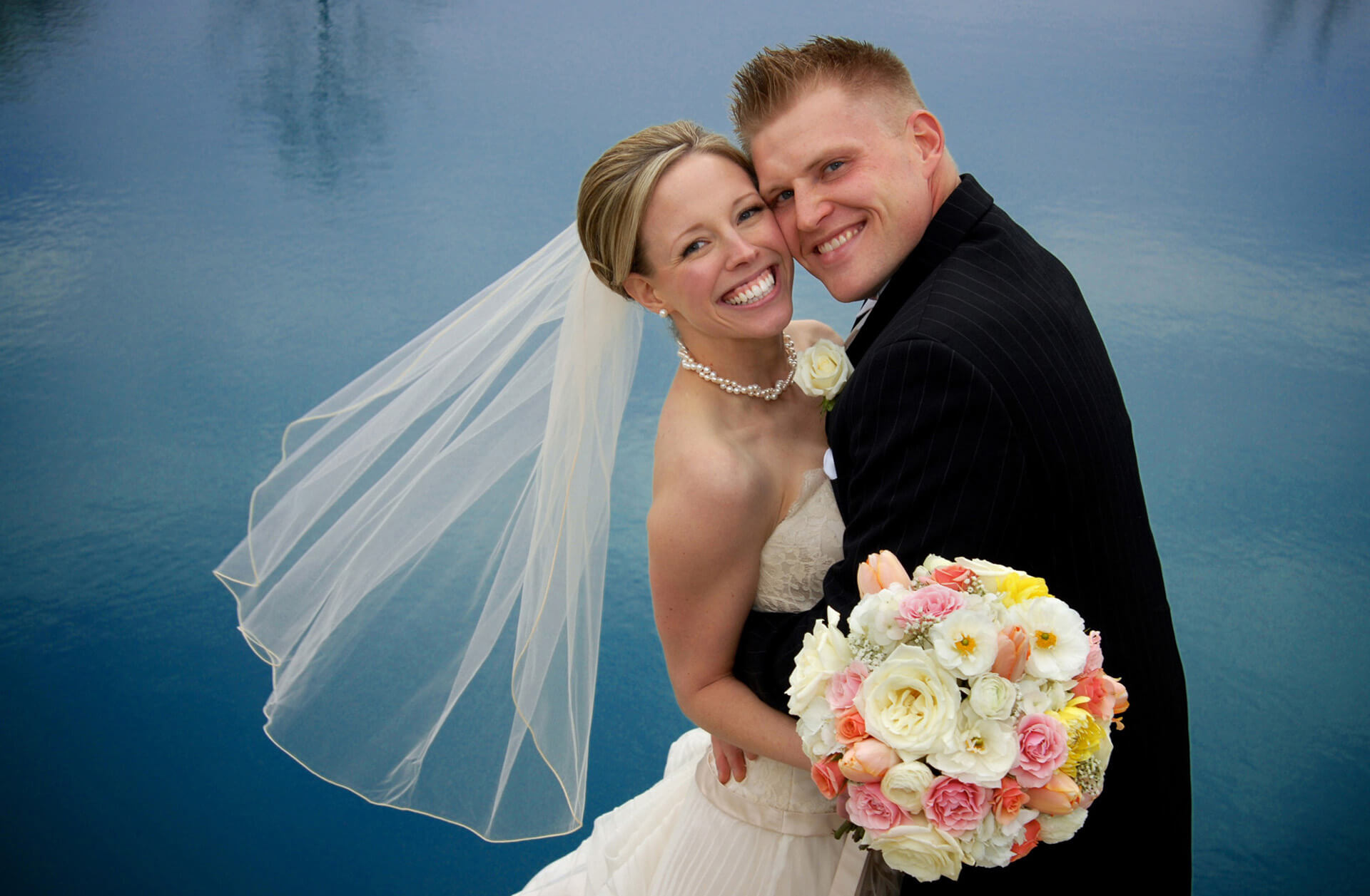 Michigan couple snuggle during a winter wedding in Grosse Pointe, Michigan.