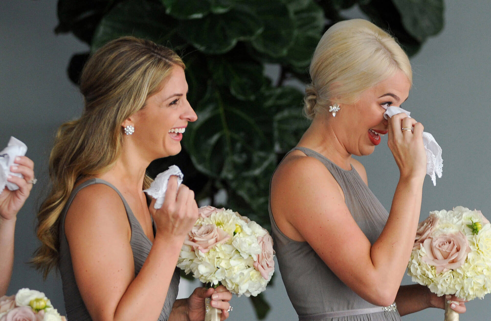 The bridesmaids tear up during a couple's vows in Detroit, Michigan's waterfront vantage point during their Waterview Loft wedding reception.