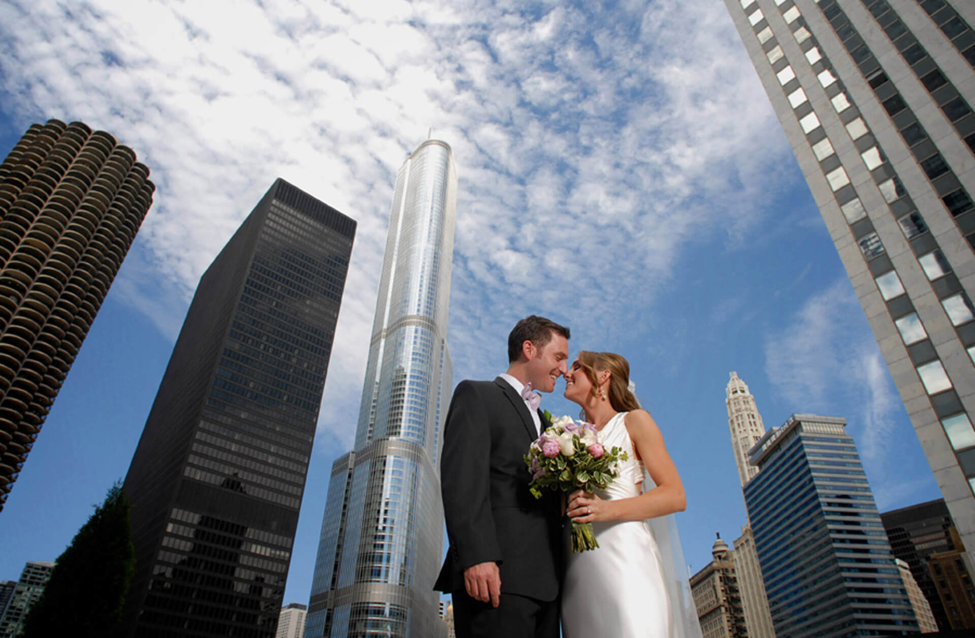 The bride and groom enjoy the city scape of Chicago for this destination wedding.