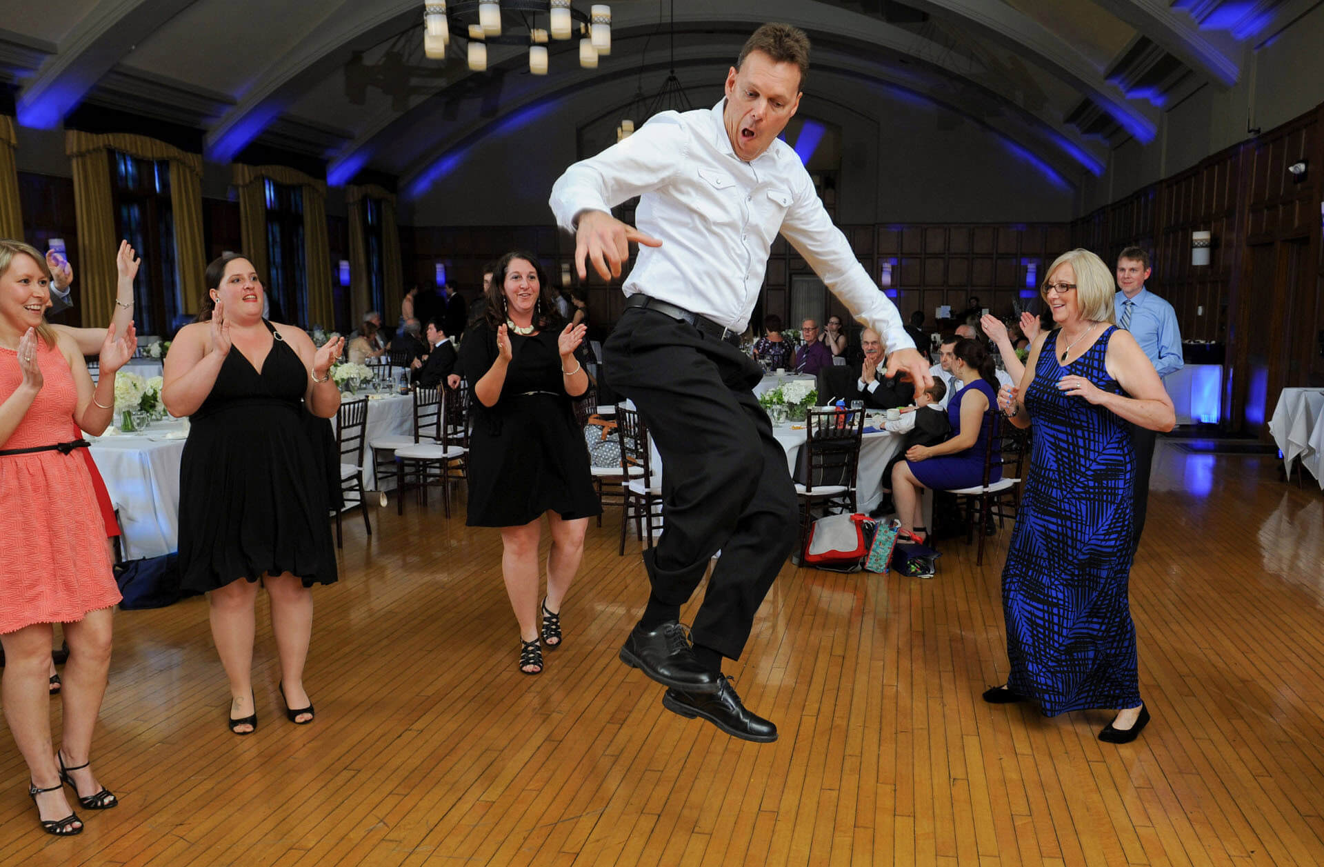 The bride's uncle cuts loose on the dance floor of this Ann Arbor, Michigan wedding taking place at the Michigan League in Ann Arbor, Michigan.