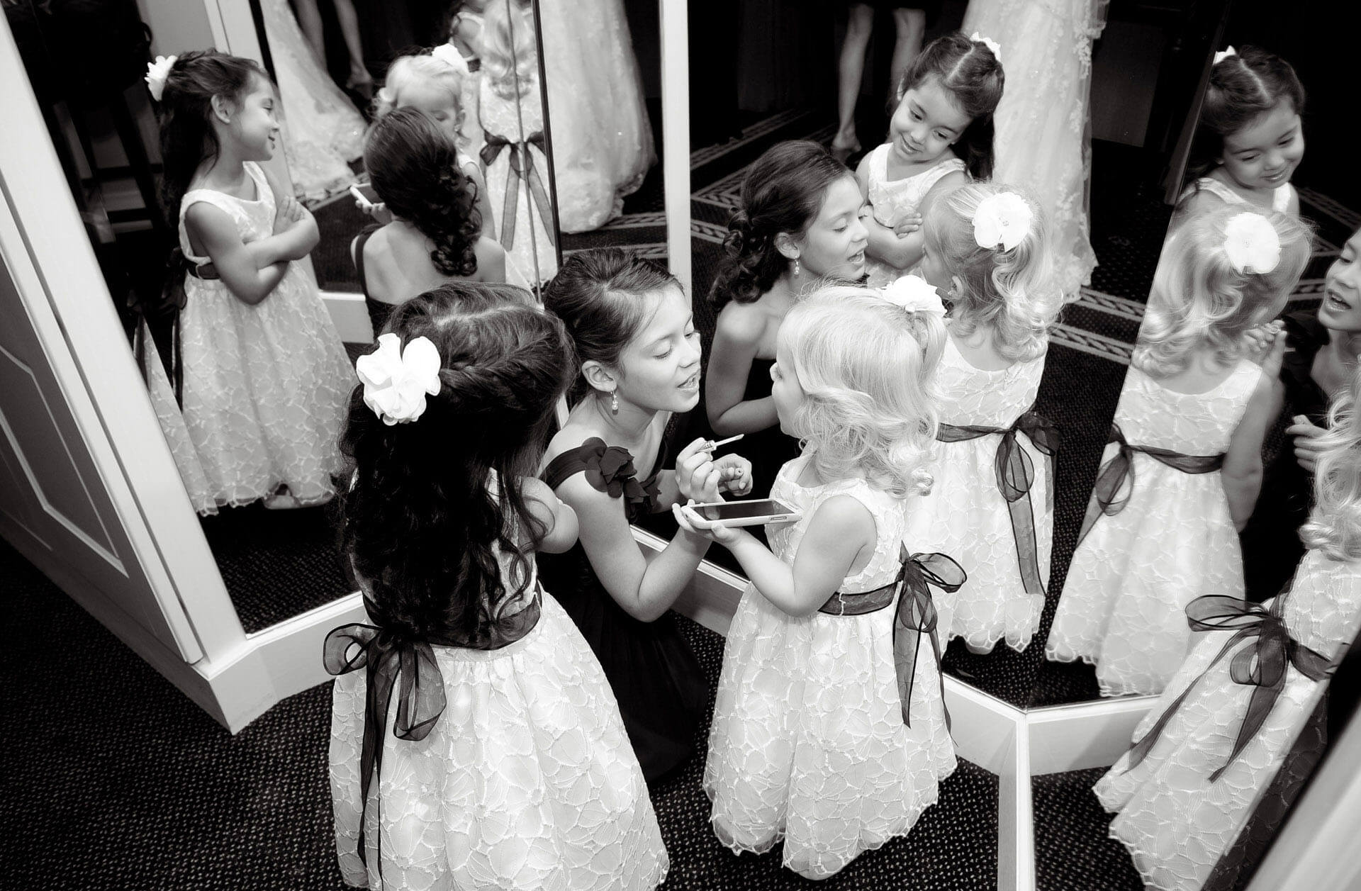 All the little girls in the wedding party at a Cherry Creek wedding in Shelby Charter Township, Michigan, try to help each other get ready.