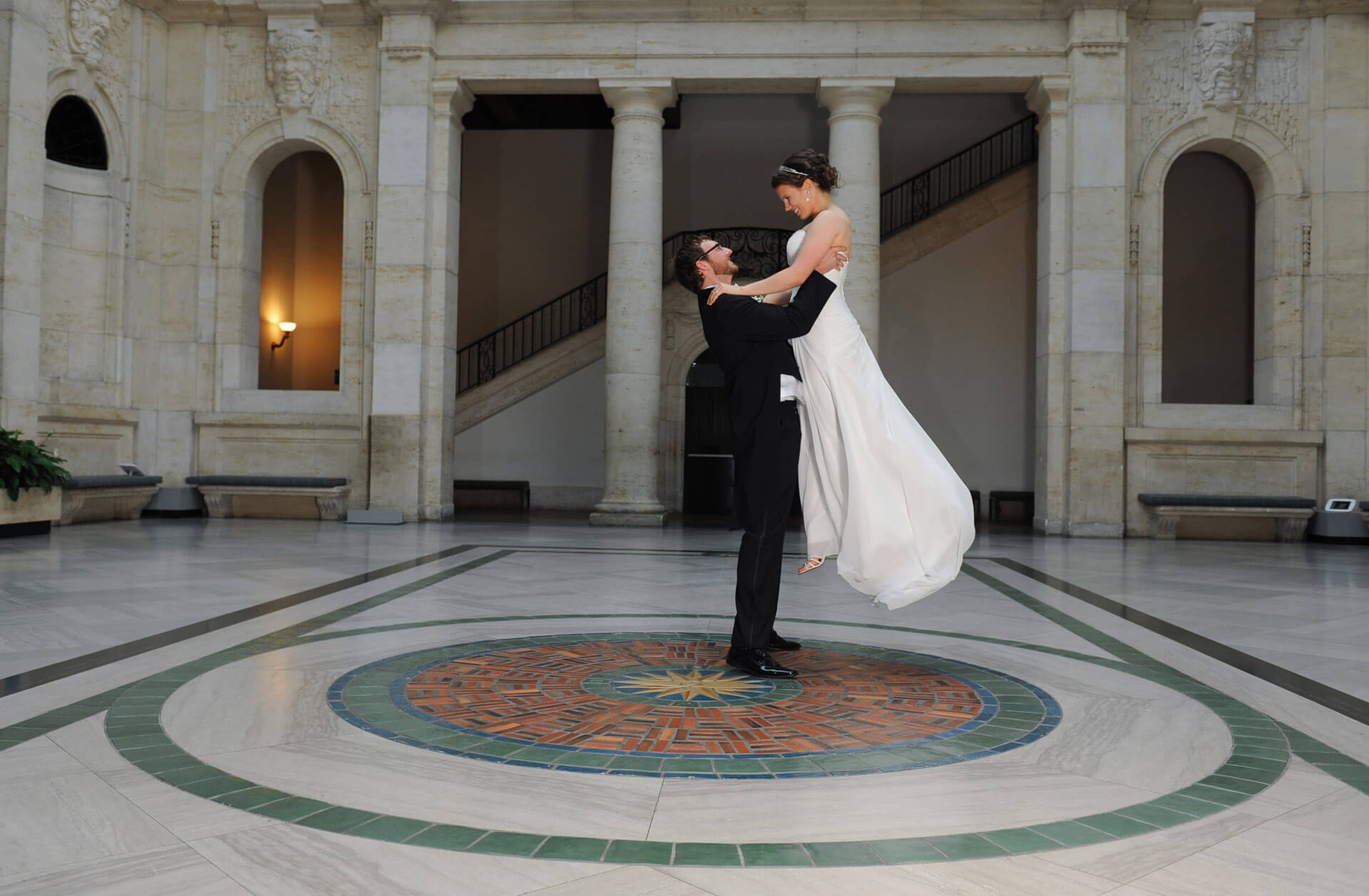 Bride and groom practice their dance at the DIA in Detroit, Michigan.