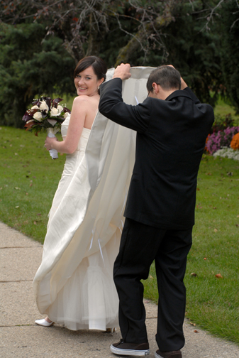 A Ferndale, Michigan wedding groom takes a peak under his bride's dress.