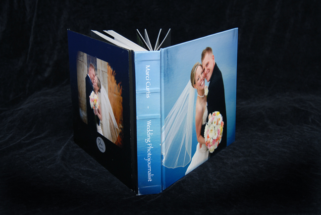 Michigan wedding photographer wedding album sample for large flushmount album features canvas stretched across the from and back cover for two images solutioingenieria Gallery