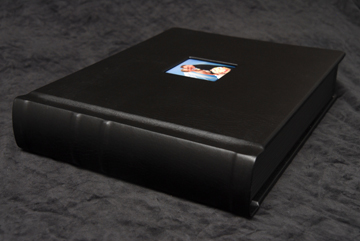 the spine of the flushmount album is leather and what you might call a traditional library look.