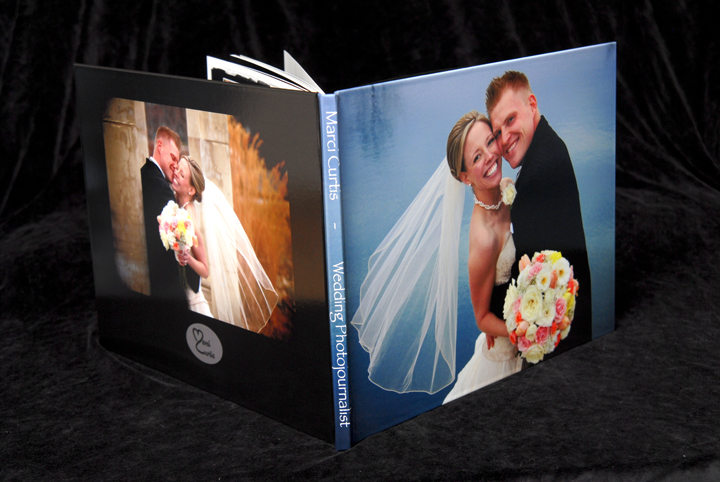 hinged art paper photo album has full cover photo on the front AND back on this book.
