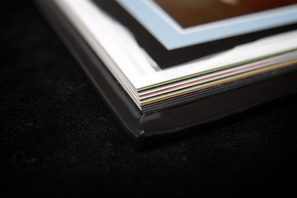 pages of the hinged paper wedding album are about as thick as two pieces of card stock put together.