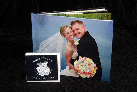 hinged art paper photo album is horizontal and a large 14 x 11 inches.