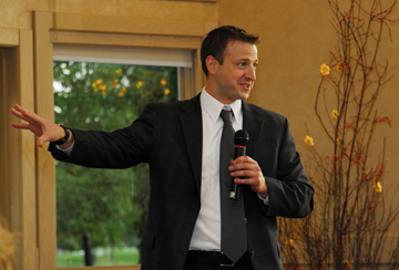 Wedding photographer in Michigan shows the best man's speech during the wedding reception at Apple Mountain in Michigan