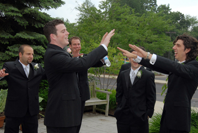 Photojournalistic wedding photos are taken by Marci Curtis to show the playfulness of the groomsmen